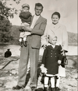 Daddy adn Mother with little brother Henry and me, about 1955.
