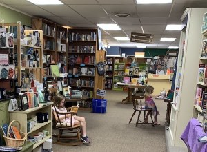 The interior of the store. Granddaughters Julia and Lydia are enjoying the books they picked.