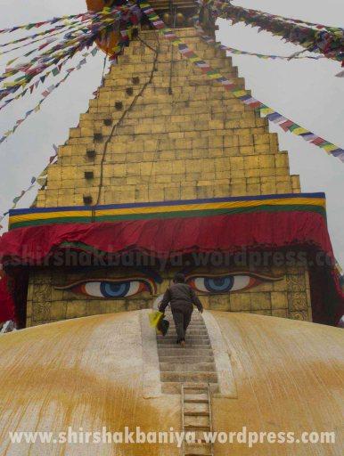 Man moving towards the top of Boudhanath stupa to install the prayer flag here at Kathmandu, Nepal.