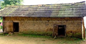 This functions as a cattle shed made up of mud, stone and timber.