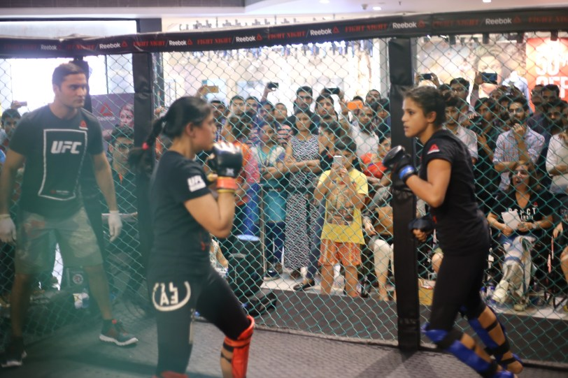 Women fighters battle it out in the MMA cage at Reebok Fight Night