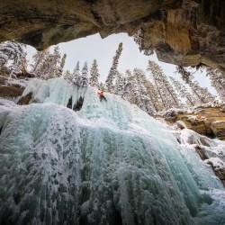 Man Climbing Ice Glacier