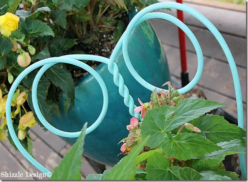 June 15 adorable metal parlor chair painted in Santa Fe Turquoise at a Shizzle Style Furniture Paint Workshop in Grand Rapids, MI  garden chair planter close up