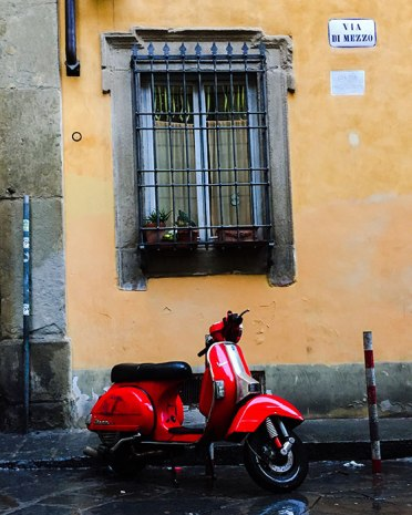 Honestly, it doesn't get more traditionally Italian than a red Vespa.