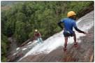 Sanoj abseiling down waterfall.