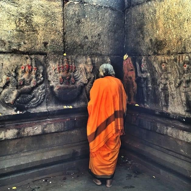 Lady communing with the divine at Someshwara temple in Ulsoor, Bangalore