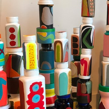 Lynda Keeler Swallowed 30x72 inches acrylic, plastic pill bottles, wood, steel, ink 2019 http://www.lyndakeeler.com/