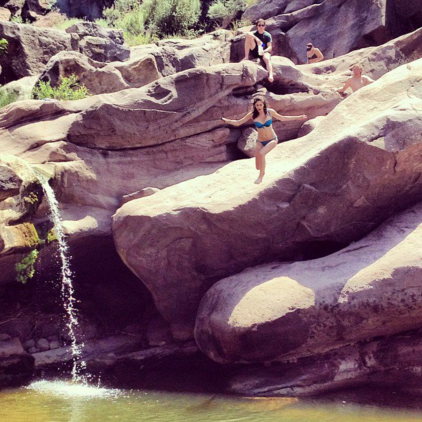 Sister jumping off the falls