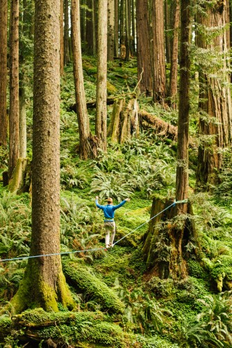 Chris Lormier highlining in a redwood forest in Arcata, CA