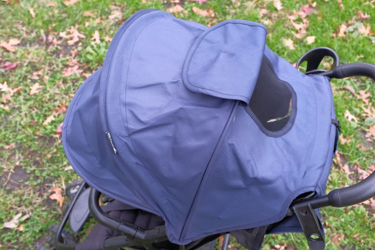 Large navy canopy on a Zoe stroller