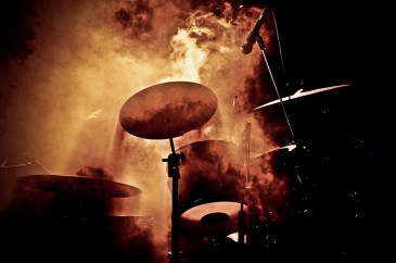 Drummer of the band Crematic X hidden behind a wall of smoke during a show.