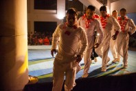 A group of acrobats coming down from stage after their performance.