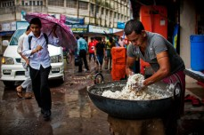 A cook prepares the dough for making breads in an old Dhaka restaurant after the rain.