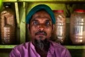 A shop keeper in Farashganj, Dhaka, Bangladesh.