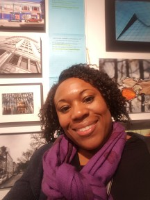 Me at Cre8ery Gallery & Studio with the art and bid sheets behind me.