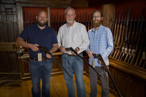 Shaun, Russell and Garrett Gordy in the gun vault in their Houston shop.