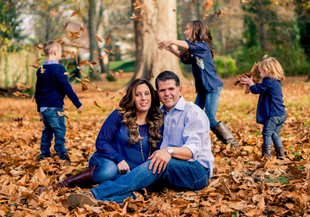 This turned out to be a fun family photograph.  Mom and dad, posed perfectly in the center and the kids being the kids they are, playing in the leaves.  In other words, perfection.