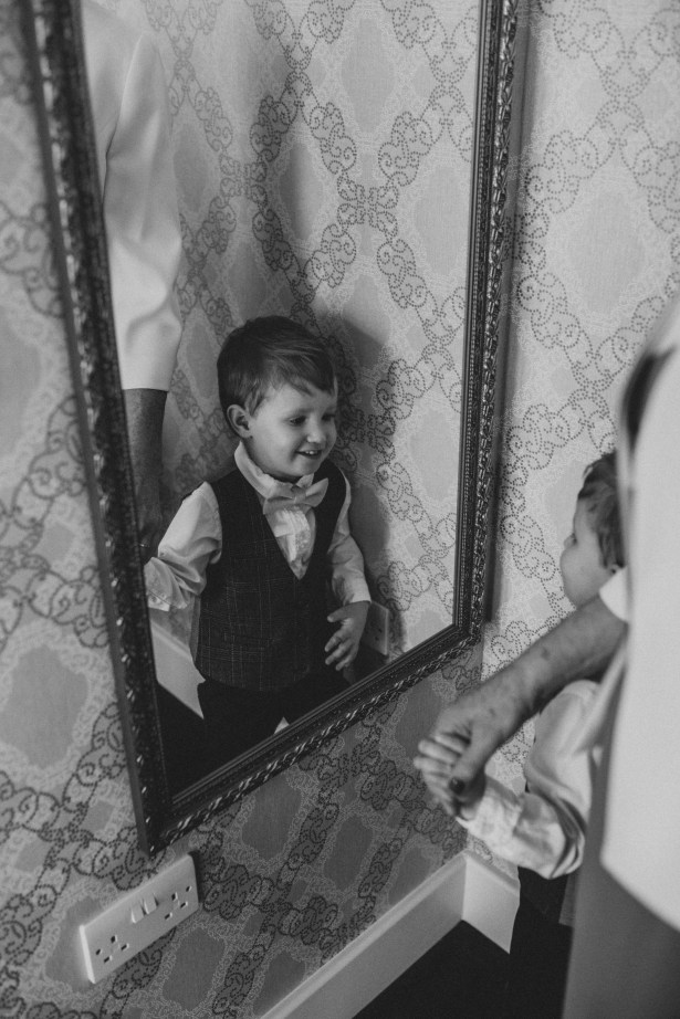 Pageboy looking in the mirror