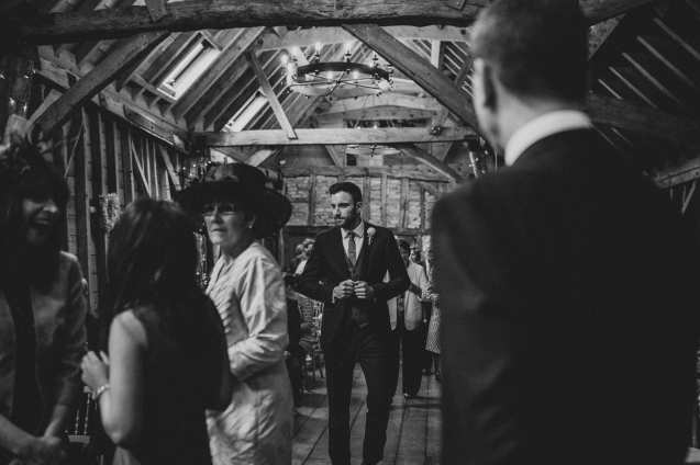Groom coming in to the ceremony at Bassmead Manor Barn
