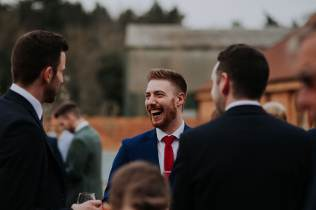 Guests having a laugh after the wedding