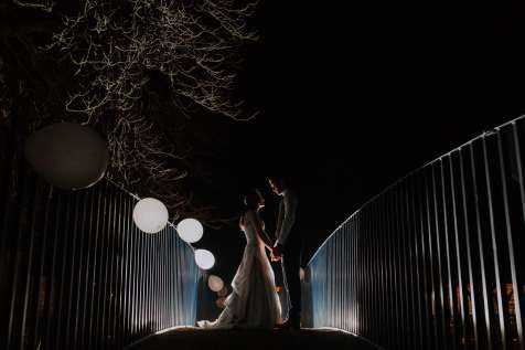 Night time portrait of bride and groom at Bassmead Manor Barns