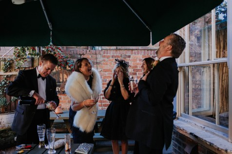 Guests laughing at the pub before wedding