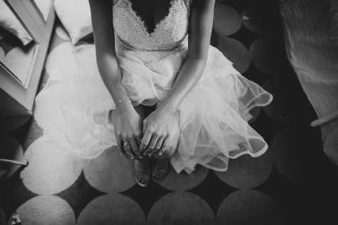 Bride sat waiting in her wedding dress