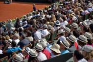 The typical French Open white hats.