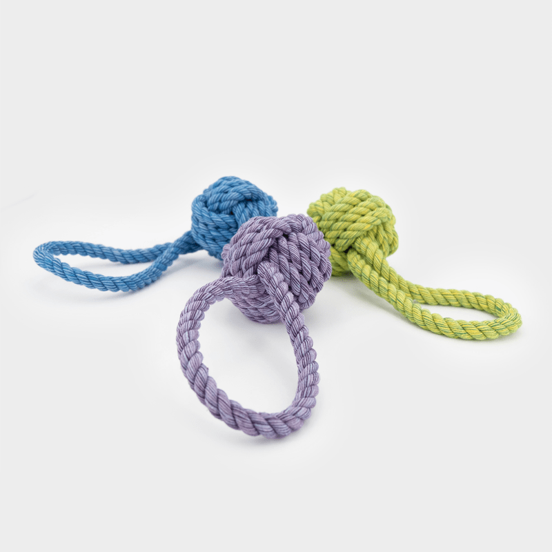 3 sizes and colors of the Nuts for Knots Ball with loop lying by Happy Pet