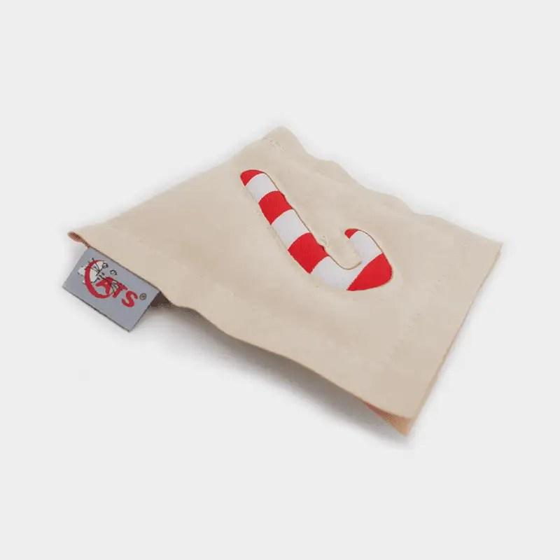 Zuckerstangen-Motiv auf einzelnem 4cats Motivkissen in der Weihnachts-Edition