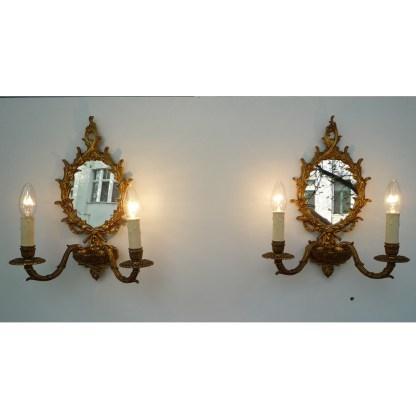 Paar Wandleuchten mit Spiegel, Messingguss, vergoldet