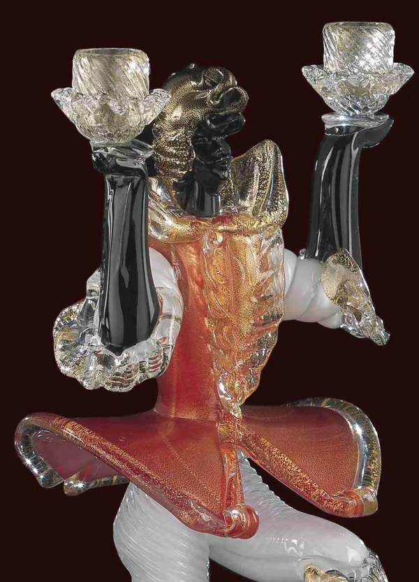 Sculpture of the Venetian Moor in Murano glass. The color of the sculpture is in red with 24K gold melted inside the glass.