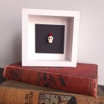 tiny glass skull and heart picture