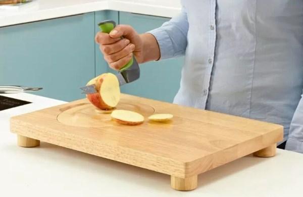Easi-Grip knife kitchen aid cutting an apple