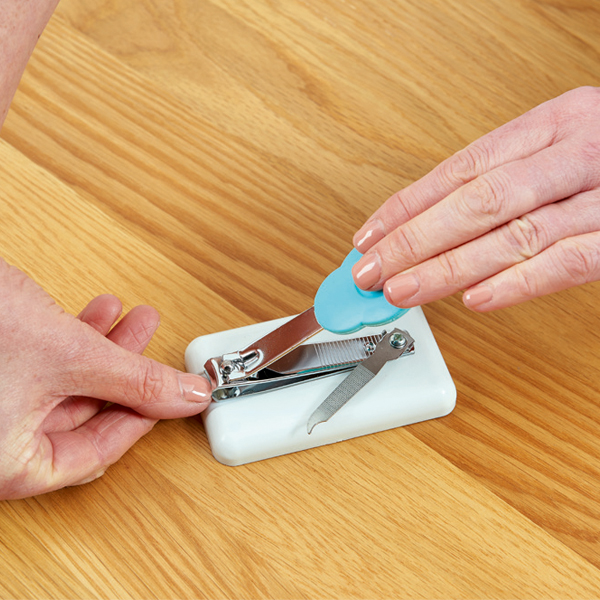 Peta Easi-Grip table-top nail clippers cutting finger nails as it's being pressed down