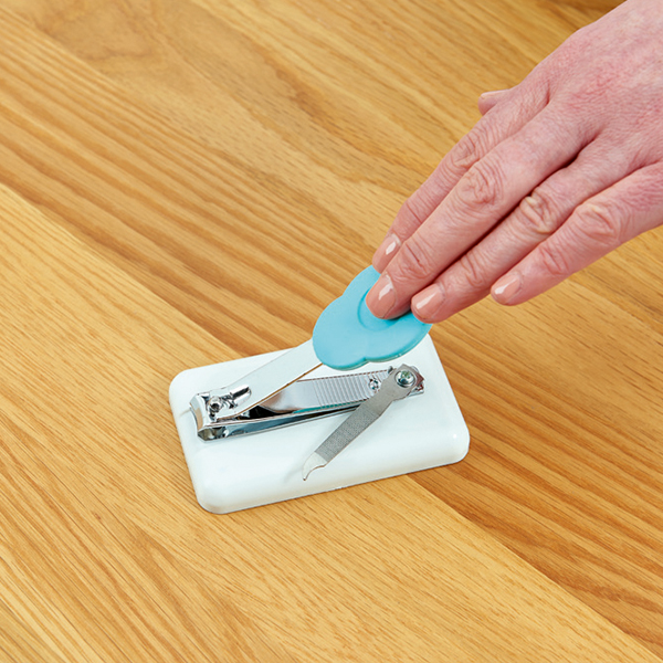 Peta table-top Easi-Grip nail clippers being pressed down by a hand