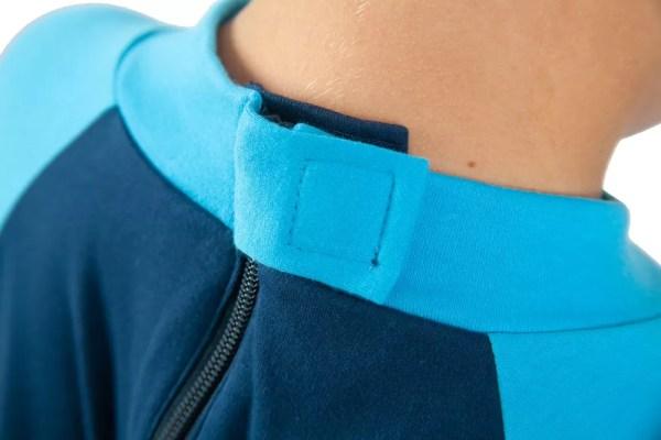 Hidden zip fastening on the back of Seenin children's turquoise and navy sleepsuit