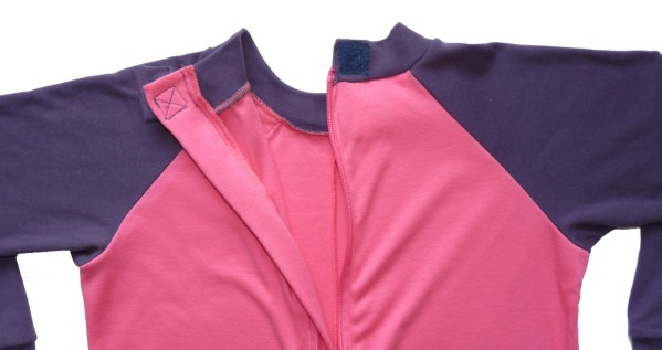 Hidden zip fastening on the back of Seenin children's pink and plum sleepsuit