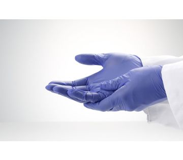 Image is a photograph of two hands wearing cornflower blue nitrile gloves for sensitive hands. Both hands are facing upwards, with one placed atop the other.