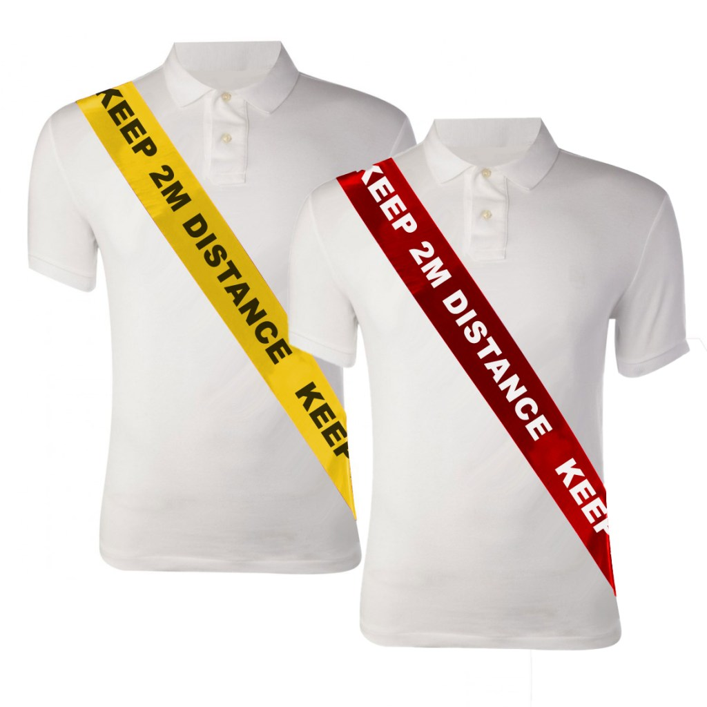 "Image is a photograph of two mannequin torsos wearing white polo shirts. Each mannequin wears a silky social distancing sash from the shoulder, around the chest and to the waist. The first sash is yellow with black text, the second is red with white text. Capitalised text reads ""KEEP 2M DISTANCE"""