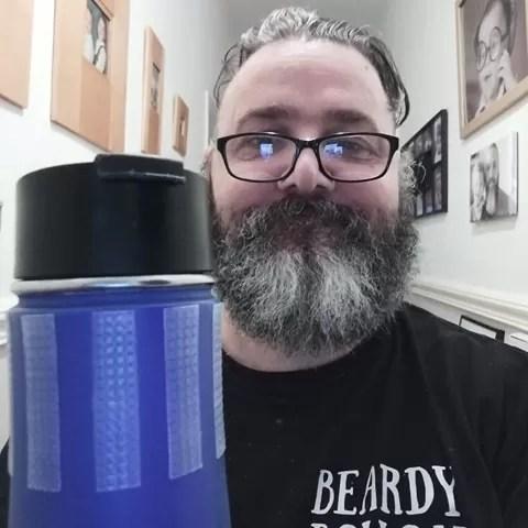 Zec Richardson holding his blue water bottle by the Cat Tongue non-abrasive grip tape