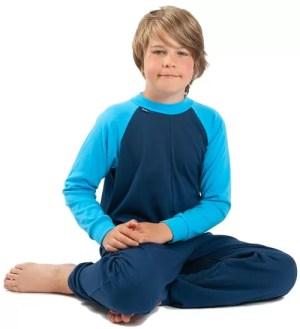 Boy wearing Seenin zip back sleepwear in blue