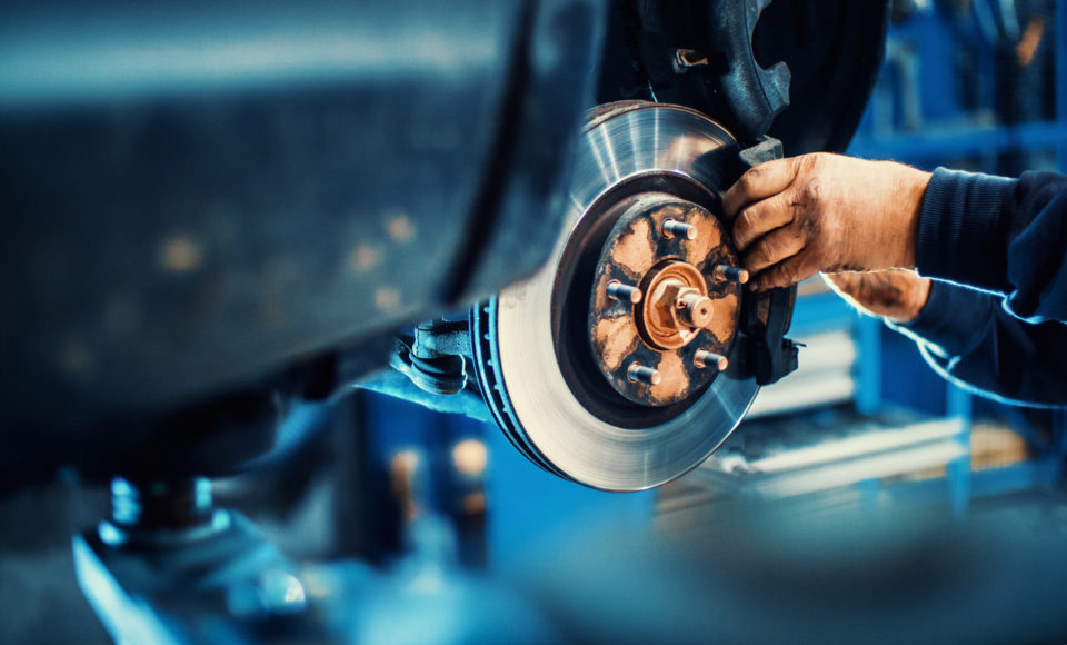 Brakes being serviced by a repair technician