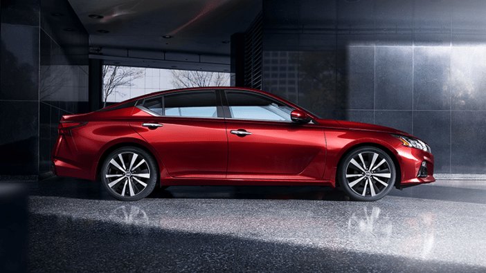 2020 altima in red in shadowy interior