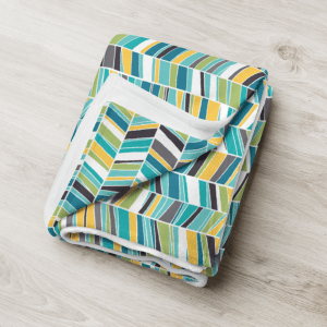 cool sketched chevron throw blanket folded on a wooden floor