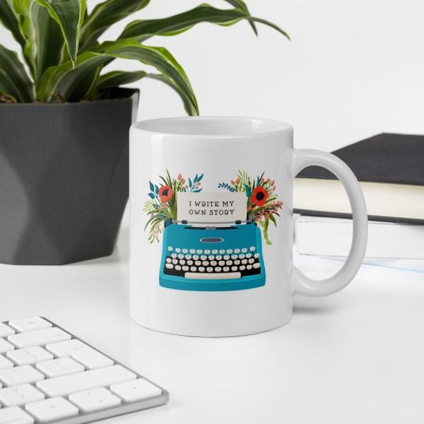 11oz my own story typewriter mug on desk