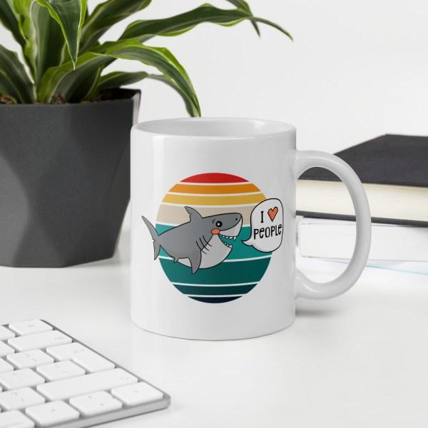 11oz I love people shark mug on desk