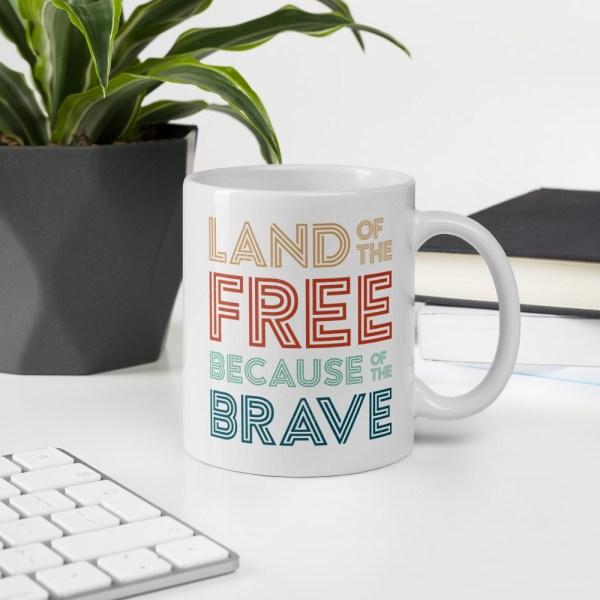 11oz land of the free mug on desk