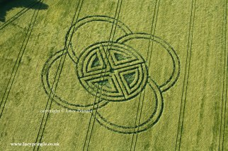 Fox Ground Down 02, Nr Blandford Forum. May 30th. Formation consisting of a ring dissected into four quadrants by two lines crossing the centre depicting a Celtic Cross. Four overlapping semicircles dissect the ring on the outside. Barley. c.180ft diameter 55 M. Image © Lucy Pringle