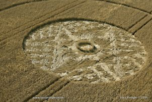Etchilhampton. Nr Devizes, Wiltshire. 8 August 2016. Wheat. c. 180 feet (55m). Ringed circle with a tightly woven flattened centre.